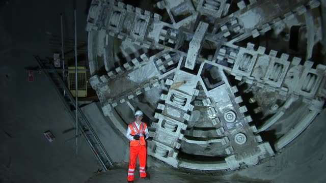 tunnelling completed in london reporter to camera - クロスレール路線点の映像素材/bロール