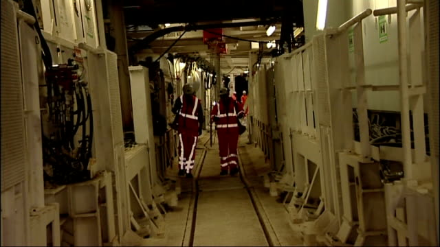 crossrail tunnel boring machines to start work on eastern section canning town reporter and main towards in tunnel - canning stock videos & royalty-free footage