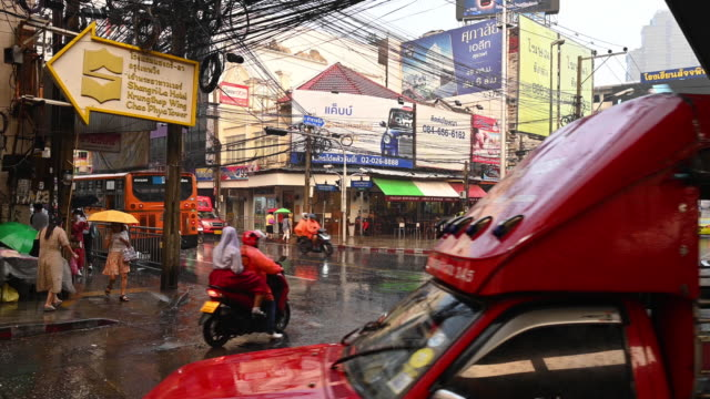 crossroad traffic in the rain, bangkok - monsoon stock videos & royalty-free footage