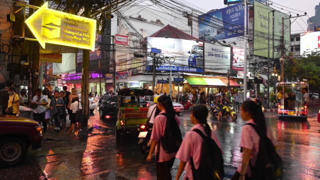 crossroad traffic in the rain, bangkok - southeast asia stock videos & royalty-free footage