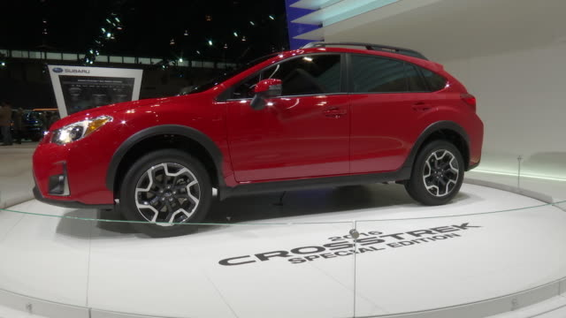 crosstrek revolving on turntable / front end / mirror / roof / wheel / tail light; rear end / info sign - subaru stock videos & royalty-free footage