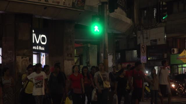 Crosswalk at Cebu city Colon street at night b-roll, Philippines