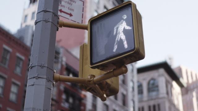 crosswalk light at manhattan intersection. - road sign stock videos & royalty-free footage