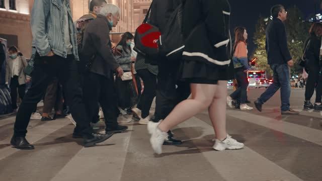 crosswalk nearby bund in shanghai at night,china. - walkable city stock videos & royalty-free footage