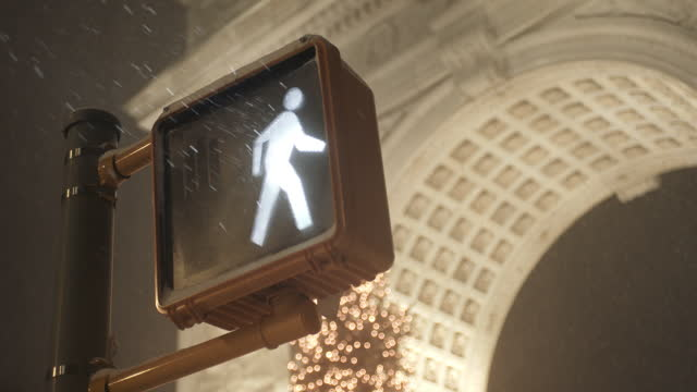 crosswalk sign beneath washington square arch - road signal stock videos & royalty-free footage