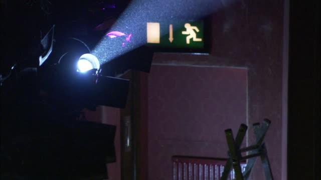 stockvideo's en b-roll-footage met a crosswalk symbol shines behind the beam of a spotlight. - keukentrap