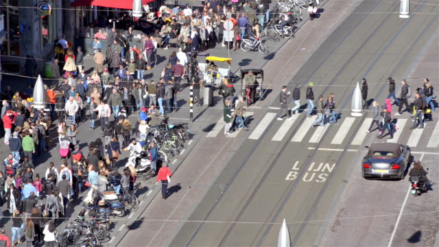 Crosswalk with pedestrians aerial view