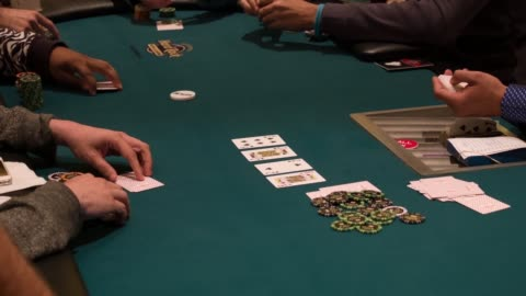 croupier dealing cards. the tournament will feature a poker championship with a $5 million guarantee, the largest guaranteed prize pool offered for a... - poker stock-videos und b-roll-filmmaterial