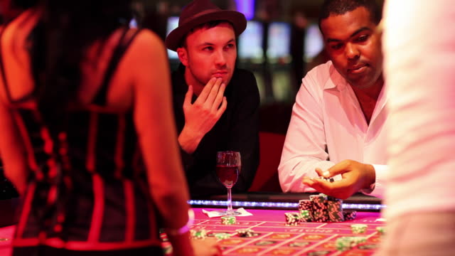 ms croupier dealing casino chips to players at roulette table / las vegas, nevada, usa - gambling chip stock videos and b-roll footage