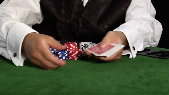 croupier dealing out cards on gambling table - dealing cards stock videos and b-roll footage