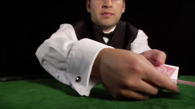 croupier dealing out cards on table - casino worker stock videos and b-roll footage
