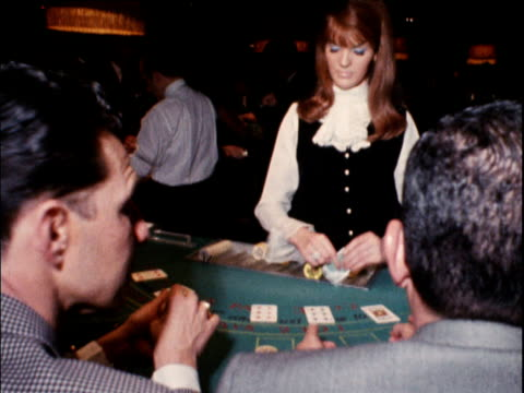 Croupier deals cards in casino UK; 16 Jan 68