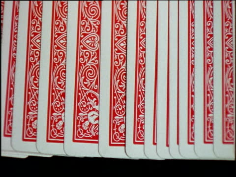 vídeos y material grabado en eventos de stock de croupier lays row of cards out on gambling table, flicks over to reveal numbers - oportunidad