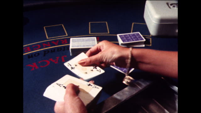 croupier opens and checks a new pack of cards; 1978 - 1978 stock videos & royalty-free footage