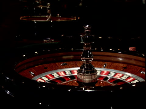 croupier places ball in roulette wheel and sets the wheel in motion - casino stock videos & royalty-free footage