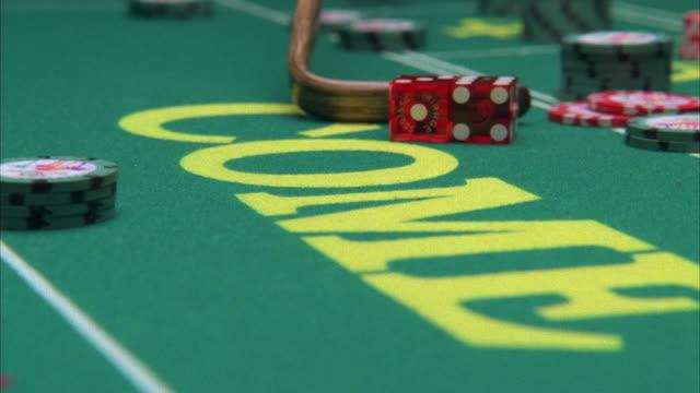cu croupier raking dice on craps table in casino / las vegas, nevada, usa - craps stock videos & royalty-free footage