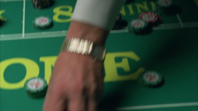cu zi pan croupier setting gambling chips on craps table / las vegas, nevada, usa - craps stock videos & royalty-free footage