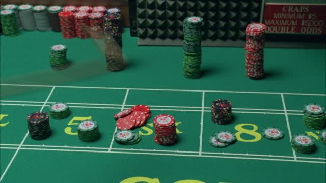cu zi zo pan croupier setting gambling chips on craps table / las vegas, nevada, usa - croupier stock videos & royalty-free footage