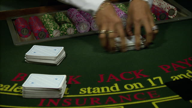 a croupier shuffles cards. - blackjack video stock e b–roll