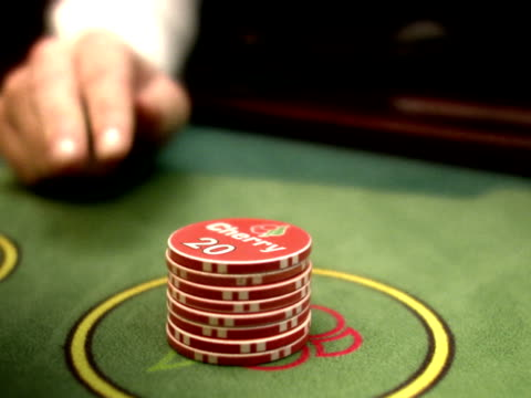 a croupier with gambling chips at a gambling table. - croupier stock videos & royalty-free footage