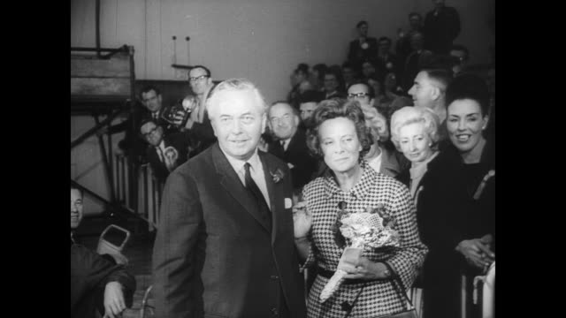 crow waves from the streets on election night in the united kingdom / labour party press conference room / prime minister harold wilson smiles as he... - harold wilson stock-videos und b-roll-filmmaterial