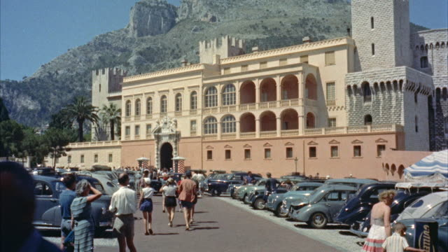 ws crowd and car in foreground of monaco palace / monaco - monaco stock videos & royalty-free footage