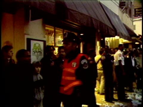 vídeos y material grabado en eventos de stock de crowd and litter outside record store - tienda de discos