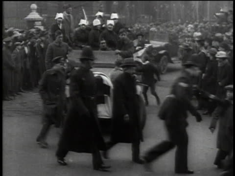 crowd and soldiers marching in front of moving vehicles during a wwi recruiting parade / united states - military recruit stock videos & royalty-free footage
