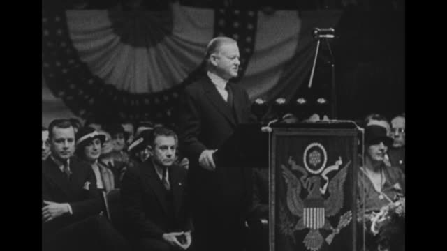 crowd applauds at detroit olympia as president herbert hoover campaigns for reelection in 1932 / first lady lou hoover sits behind at right as hoover... - herbert hoover us president stock videos & royalty-free footage
