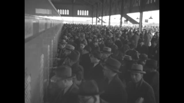 crowd at belmont race track in elmont new york / couple looks over racing form / man at wire of betting window stepping away / large crowd under roof... - starting gate stock videos and b-roll footage