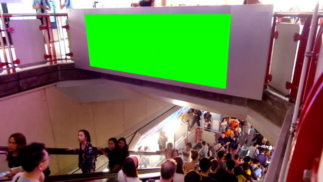 crowd at electric sky train station with green screen billboard - underground rail stock videos & royalty-free footage