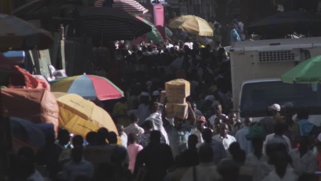 ws pan crowd at market  / kampala, kampala, uganda - kampala stock videos & royalty-free footage