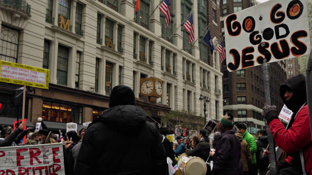 crowd at new york street. jesus message. broadway - protestor stock videos & royalty-free footage