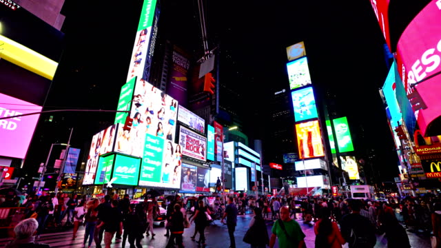 crowd at night time square - billboard stock videos & royalty-free footage