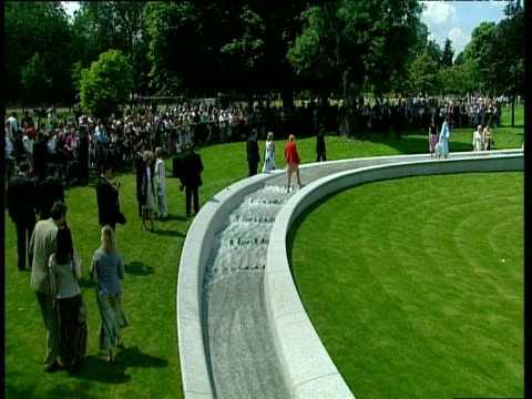 crowd at opening of diana memorial fountain made of white granite hyde park london 06 jul 04 - igneous stock videos & royalty-free footage