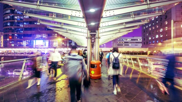 crowd at public walk way in hong kong island city at night with raining, time lapse - elevated walkway stock videos & royalty-free footage
