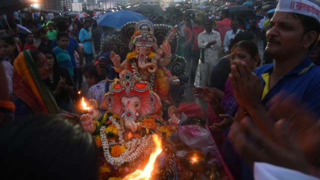 crowd at religious procession during ganpati visarjan ceremony, mumbai, maharashtra, india - god stock videos & royalty-free footage