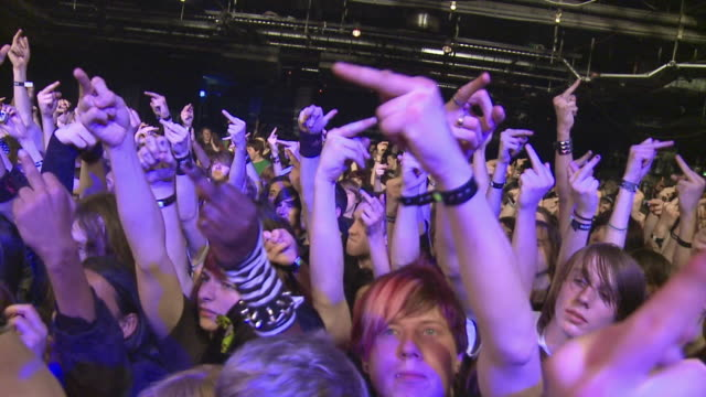 slo mo ms crowd at rock concert / london, united kingdom - v sign stock videos & royalty-free footage