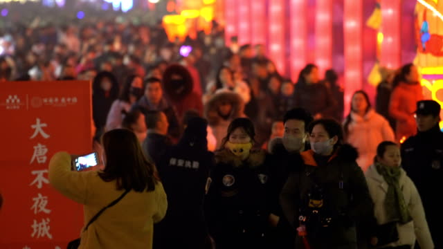 crowd at scenic spot for celebrate chinese spring festival / xi'an, shaanxi, china - 春節点の映像素材/bロール