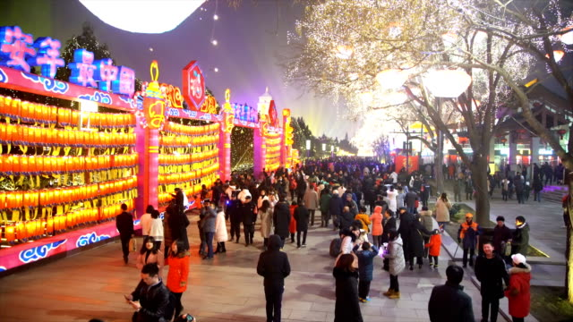 crowd at scenic spot for celebrate chinese spring festival / xi'an, shaanxi, china - 中国文化点の映像素材/bロール