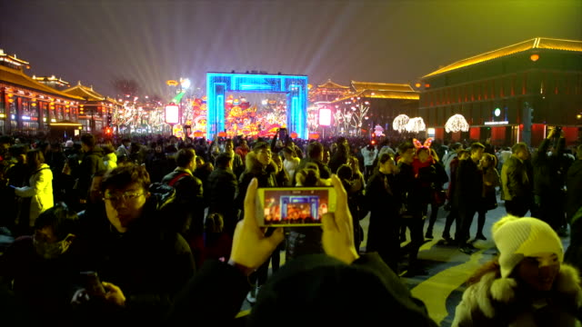 crowd at scenic spot for celebrate chinese spring festival / xi'an, shaanxi, china - tourism点の映像素材/bロール