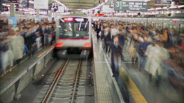t/l ws crowd at shibuya station, tokyo, japan - railway station platform stock videos & royalty-free footage