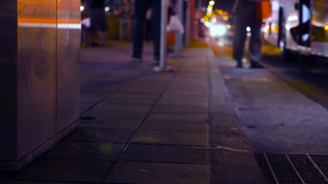 crowd at the bus station in the city at night. - borsetta video stock e b–roll
