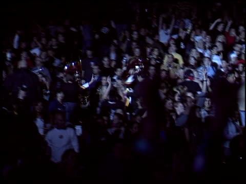 crowd at the kroq almost acoustic christmas day at universal amphitheatre in universal city, california on december 13, 2003. - kroq stock videos & royalty-free footage
