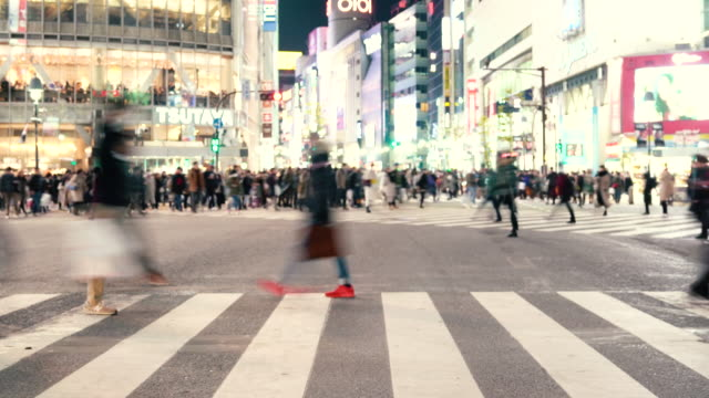 crowd at the scrambled intersection in shibuya,tokyo japan - cross stock videos & royalty-free footage