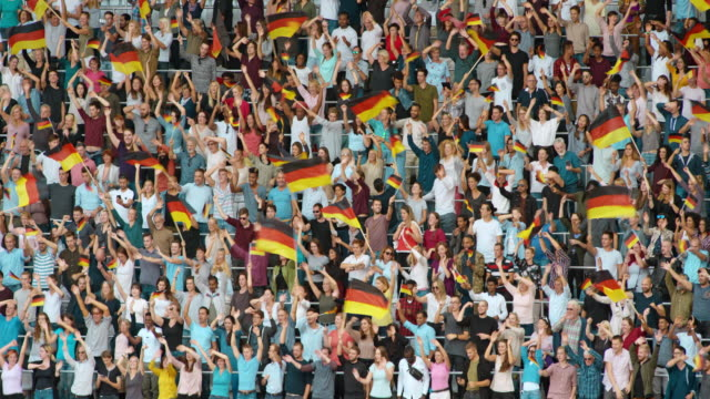 LD Crowd at the stadium cheering and enthusiastically waving the German flag