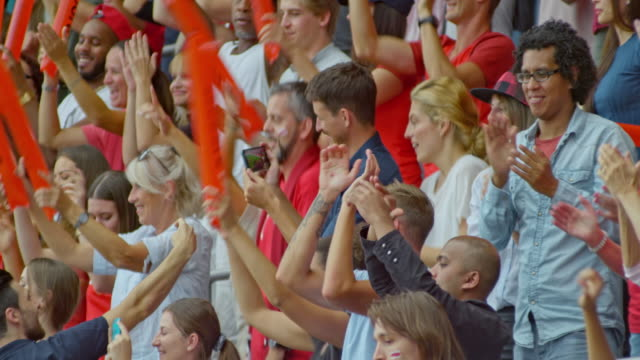 stockvideo's en b-roll-footage met crowd at the stadium dancing and cheering at the game - toeschouwer