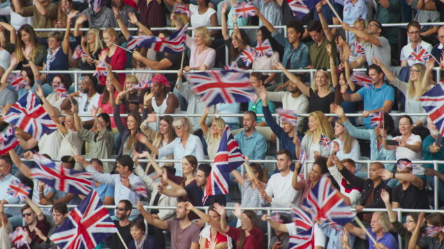 LD Crowd at the stadium sitting and waving the British flags