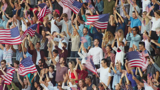 LD Crowd at the stadium standing up and waving American flags