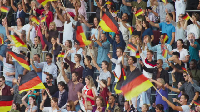 LD Crowd at the stadium waving German flags on the tribune